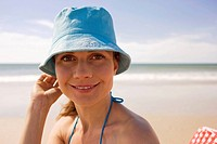 Germany, Baltic sea, Young woman on beach, smiling, portrait, close_up