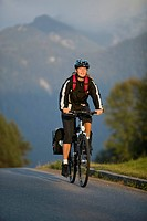 Germany, Bavaria, Mittenwald, Woman mountain biking