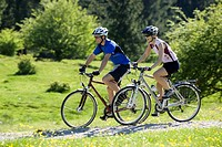 Germany, Bavaria, Couple mountainbiking