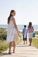 Children walking on beach boardwalk