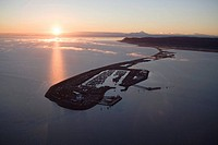 Aerial view of Homer Spit at sunset on Kachemak Bay with view of Mt.Iliamna in the backgroung Kenai Peninsula Alaska Summer