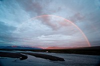 A rainbow shines over the Canning River in ANWR. Summer in Arctic Alaska.