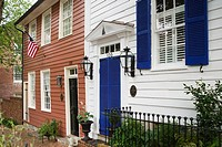 Historic row houses with an American flag in a residential area of Old Town, Alexandria, Virginia, USA
