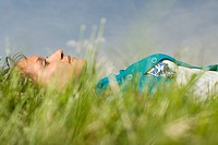 Woman lying in grass
