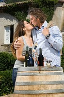 Couple kissing with wine