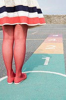 Young woman playing hopscotch