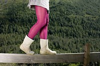 Girl walking on a wooden fence (thumbnail)