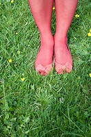 Woman in pink tights standing on grass