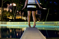 Woman standing on a diving board