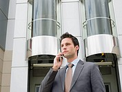 A businessman using a cell phone