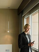 Portrait of a businesswoman using a cell phone