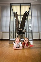 Children with stuffed eagle in a museum