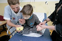 CHILD HOSPITAL PATIENT WITH NURSE Photo essay at the hospital of Meaux 77, France. Pediatric emergency department. Doctor and nurse with a child havin...