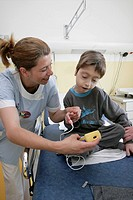 OXIMETRY Photo essay at the hospital of Meaux 77, France. Pediatric emergency department. Doctor and nurse with a child having respiratory disorders. ...