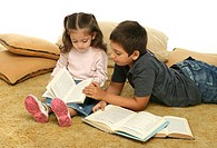 Brother and sister reading books