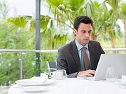 A businessman using a laptop