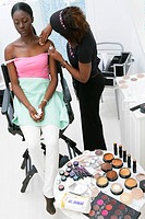 WOMAN PUTTING ON MAKE_UP Models.