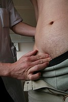 ABDOMEN, SEMIOLOGY Photo essay from hospital. Palpation of the abdomen for the search of an abdominal hernia.