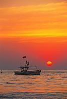 Colourful sunset with fishing boat , Juhu beach , Bombay Mumbai , Maharashtra , India
