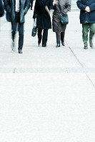 Cropped view of pedestrians on sidewalk