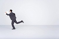 Businessman running with document