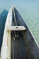 Wooden canoe in shallow water, cropped