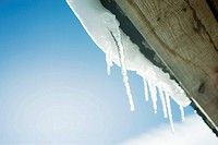 Icicles hanging from ledge, low angle view