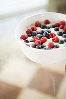 Bowl of berries and cream