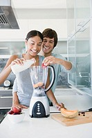 Couple preparing smoothies