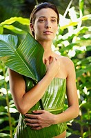 Woman wrapped in banana leaf