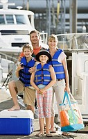 Smiling family on boat dock