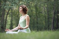 Woman meditating at the park