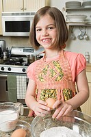 Girl baking in a kitchen