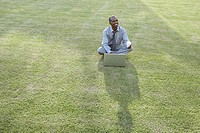 Financial advisor sitting on the grass