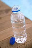 Bottle of water by swimming pool (thumbnail)