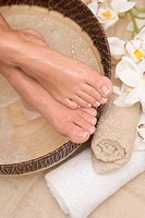 Woman enjoying a soothing foot bath (thumbnail)