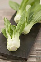 Fresh pak choi on chopping board (thumbnail)
