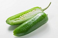 Green chilli with drops of water, halved (thumbnail)