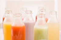 Various different juices in small bottles