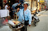 Woman carrying eggs in basket, Chiang Mai, Northern Thailand