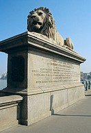 Lion statue on Chain Bridge, Szechenyi Lanchid, over the River Danube, Budapest, Hungary