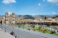 Looking across Plaza de Armas to Iglesia La Compania de Jesus on the left, Cusco, Peru