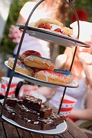 Brownies, doughnuts & strawberry shortcake on tiered stand