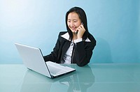 Portrait of businesswoman on phone
