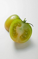 Green tomato, halved