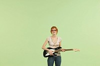 Woman with sunglasses and guitar