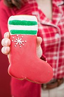 Woman holding red gingerbread boot