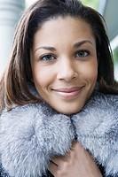 Woman clutching her fur collar