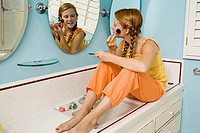 Preteen girl applying makeup