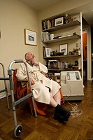 Elderly man using an oxygen concentrator at home. Also called an oxygen generator, this medical device provides high_concentration oxygen derived from...